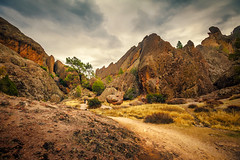Pinnacles Trail - Textured HDR (byron bauer) Tags: byronbauer pinnacles nationalpark central california eroded volcano storm clouds sky rock hills formation trees scrub sanbentocounty montereycounty texture painterly topaz simplify restyle landscape desert hiker hdr highdynamicrange color treatment