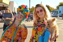 Crossing the street before the parade (radargeek) Tags: dayofthedead 2018 october plazadistrict okc oklahomacity facepaint flowers portrait tattoo dog bluehair sunglasses heart skeleton