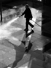 Floor Washing at the Cinematheque B&W (zeevveez) Tags: זאבברקן zeevveez zeevbarkan canon bw people work water reflection