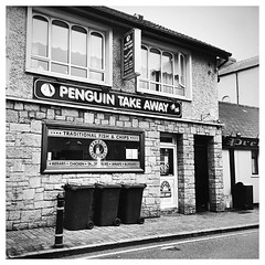 Tastes just like chicken (Julie (thanks for 9 million views)) Tags: 100xthe2019edition 100x2019 image51100 takeaway newross iphonese hipstamaticapp bw monochrome wall window hww ireland irish street fastfood sign hss signsunday