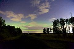September 10 2018 (John Andersen (JPAndersen images)) Tags: alberta aurora clouds kananaskis logs night pond rocks sky smoke springbank trees