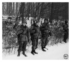 """On the Road to Bastogne - 1944"" (photo_secessionist) Tags: war ww2 secondworldwar reenactors winter snow soldiers americn gi paratroopers 101stairborne leica leicaiiia 1939 film 35mm analog blackwhite bw bn vintagecamera leitz elmarf355cmlens ilford hp5 selfdeveloped kodak d76 scannedfromnegative"
