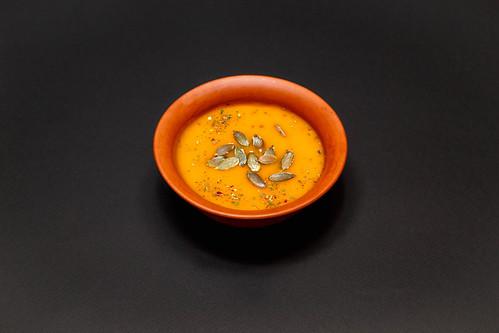 Pampkin cream-soup on black background