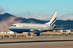 Sands 737 (dmeg180) Tags: airplane aircraft jet corporate lasvegas las klas mccarran airport boeing 737 733 runway nevada nikon d500 70200mm sands n789ls sky clouds mountains