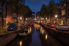 Blauwburgwal, Amsterdam (alowlandr) Tags: boats trees cars nopeople streetlamp historical bluehour dusk night illuminated residential city amsterdam canal