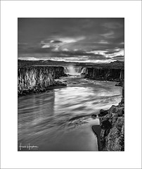 The World Below VII (Frank Hoogeboom) Tags: selfoss iceland ijsland waterfall water flow rapid rocks hills mountains cave river rugged wild blackwhite blackandwhite monochrome mono fineart longexposure gorge nature outdoors scandinavia travel sunset landscape waterscape