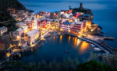 Nights in Vernazza (One_Penny) Tags: italy cinqueterre photography tuscany canon6d night nightphotography evening dusk twilight blue bluehour city town village house church tower waterfront harbour view scenery italia romantic beautiful tourism travel architecture cityscape sea water mediterranean mediterraneansea lights illuminated vernazza ligurien liguria boat reflections