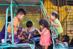 New Toy (Beegee49) Tags: children playing boys girls filipino tricycle street luminar sony a6000 happyplanet bacolod city philippines asia asiafavorites