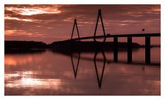 Farø Bridges (south bridge) II ([ Time - Beacon ]) Tags: tb bridge sky clouds water sea reflections sunset sundown denmark silhouettes