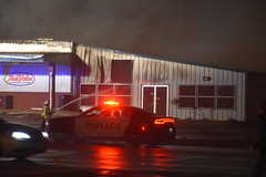 Fire - MFA Agri Services (Adventurer Dustin Holmes) Tags: firefighting fire mfa mfaagriservices lacledecounty lebanonmo lebanon lebanonmissouri missouri emergency event events news photography structure business building night february 2019 downtown smoke smoky smokey lowlight policecar lpd lebanonpolicedepartment lebanonpolicedept emergencyvehicle car dodge dodgecharger lawenforcement police policecruiser lebanonpolice firstresponders responders emergencyvehicles vehicle vehicles spraying water window firefighter people person truevalue doors windows door entrance damage damaged wall outdoor burned burning firefighters destroyed