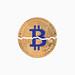 Bitcoin broken in half on white background