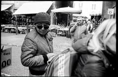 (The Lurker) (Robbie McIntosh) Tags: leicam2 leica m2 rangefinder streetphotography 35mm film pellicola analog analogue negative leicam summilux analogico leicasummilux35mmf14i blackandwhite bw biancoenero bn monochrome argentique summilux35mmf14i autaut dyi selfdeveloped filmisnotdead kodaktrix400 kodak trix d76 kodakd76 leicasummilux35mmf14 summilux35mmf14preasph street man woman religion market jesus smugglers