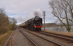 Locomotive 70013 'Oliver Cromwell' passing over Swithland Reservoir, with the 11.00 departure from Loughborough to Leicester North. 30 12 2018 (pnb511) Tags: greatcentralrailway trains railway locomotives loco steam standardclass7 carriage track smoke olivercromwell 70013 engine pacific 462 standard water reservoir