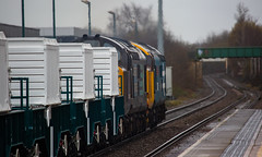 DRS Class 37/4's no's 37402 & 37425 approach Mansfield Station on 07-03-2019 with brand new Nuclear Flasks from W.H Davis bound for Crewe (kevaruka) Tags: class37 syphon growler 37402 37425 drs directrailservices nuclear nuclearwaste cnd britishrail networkrail englishelectric mansfield nottinghamshire winter 2019 march kevinfrost gloom dull drearyday rain rainyday railway railfreight trains train clouds cloudy cold flickr frontpage thephotographyblog telephoto telephototrains canon canoneos5dmk3 canon5dmk3 canonef100400f4556l 5d3 5diii 5d 5dmk3 37 colour colours color colors blue yellow outdoor