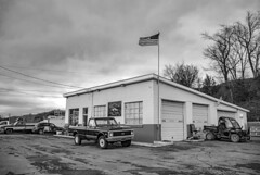 Happies Car Care_BW (Bob G. Bell) Tags: garage servicestation gasstation carrepair chevy c10 flag oldglory usa clouds bobbell lindside wv monroe johndeere winter weather