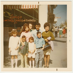 Vintage 1970 Square Snapshot : Family Of Long's Drug Shoppers (CHAIN12) Tags: photo scan scanned vintage square family girl boy man woman 1970 hair nerdy kids storefront longs thousands things dv331970junefamilyofshoppers drug store