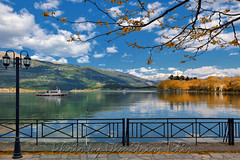 Sailing boats and reflections at Pamvotis Lake (Dimitil) Tags: boats reflections clouds epirus forest greece hellas ioannina ioanninaislet lake mountain nature pamvotis pamvotislakeislet sky snow tradition trees greecehellas