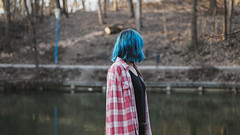 Out of the Blue (Michael Xyrie) Tags: girl adult youngadult woman portrait bluehair colors colorful sharp wide lake reflections bokeh winter cold sunny outside outdoor park urban