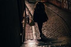 Go Walkies (Tom Levold (www.levold.de/photosphere)) Tags: brussels bruxelles brüssel fujixpro2 xf56mmf12 street ig night nacht regen rain spiegelung reflection copplestones pflaster dog hund frau woman