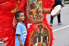 Posing with NOLA Mardi Gras Indian (dr_marvel) Tags: jersey 23 nola neworleans louisiana red colorful mardigrasindian parade posing beads feathers