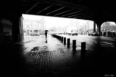 """Under the Bridge"" (Arif Kavak Street Photography) Tags: photoderue people personnage photography paysage bridge monochrome man noiretblanc noir blanc black white nmbs sncb rain rainy landscape blackwhite bw belgium brussels streetphotography street sun sky station reportage railway rail reflect train"