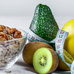 Oat flakes with fresh fruit and nuts and measuring tape thumbnail