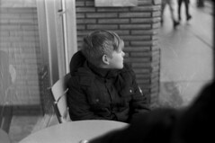 Micah Waiting (Pics from the Bird Cage) Tags: argentique leica leicaiiic rangefinder hp5 film ilfordhp5plus400 35mm alberta ishootfilm leica3c ilfordhp5plus ilfosol3 edmonton edmontonalberta blackandwhite blackwhite summitar summitar5cmf20 barnack whyteavenue analog analogue bulkfilm classiccamera camera monochrome iso iso400 portrait streetphotography strathcona