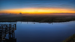 Down by a Dock on the St. Johns River (Ed Rosack) Tags: grass usa sunrise riverscape dawn pasturefield ©edrosack panorama florida river reflection water landscape sky centralflorida mist fog swamp stjohnsriver christmas us