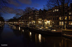 Amsterdam. (alamsterdam) Tags: amsterdam city canal keuzersgracht longexposure reflection boats evening clouds bikes cars architecture