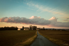Parrish Sky (Jen MacNeill) Tags: clouds sky weather pa pennsylvania lancaster county rural country colorful farm barn silo road leading lines drive barns agriculture sunset sundown