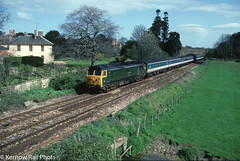 Sir Edward Elgar bound for Yeovil in 1991 (Kernow Rail Phots) Tags: 50007 siredwardelgar hercules class50 br britishrail sherborne 1441991 yeoviljunction waterloo sunday 14th april 1991 1990s tarin trains railway railways railroad scenic sunny trees bluesky buildings hoover passengertrain mk2 coaches nse networksoutheast
