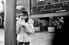 Flanagan's (Owen J Fitzpatrick) Tags: ojf people photography nikon fitzpatrick owen pretty pavement chasing d3100 ireland editorial use only ojfitzpatrick eire dublin republic city tamron candid joe candidphotography candidphoto unposed natural attractive beauty beautiful woman female lady j face hair along bw black white mono blackwhite blackandwhite monochrome blancoynegro pretoebranco photoshoot street asian portrait brunette smoking ciggie cigarette cap fleece earplugs flanagans restaurant device phone eastern streetphotography streetphoto coat girl girls ladies visage earplug irish