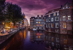 Amsterdam canal at blue hour (dleiva) Tags: amsterdam bridgebuiltstructure church cityscape sunset apartment architecture blue builtstructure canal capitalcities city citystreet clearsky cultures dusk dutchculture electriclamp europe famousplace history house illuminated journey lightnaturalphenomenon lightingequipment locallandmark longexposure nauticalvessel netherlands night nopeople outdoors photography reflection road rowhouse sky socialhistory square street streetlight tourism townhouse travel traveldestinations vacations water westerneurope window dleiva domingo leiva