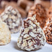 Pyramid candies assorted in white, milk and black chocolate