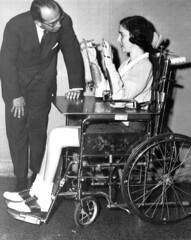 PolioQuad_ArmBraces (jackcast2015) Tags: polio caliper disabledwoman disabled legbraces calipers disabledwomen handicappedwomen armbrace crippledwoman wheelchair vintagewheelchair