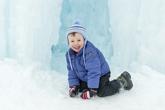 Little Boy Emerging from Ice Cave (aaronrhawkins) Tags: boy child children nephew smile cave cavern tunnel ice winter cold icicle icecastles hat coat gloves crawl fun blue freeze frozen snow midway utah festival davy aaronhawkins