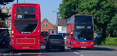 Either Way, It's A 179 (M C Smith) Tags: bus buses red traffic northchingford pentax k3 trafficlights trees green tree busshelter shops cars letters numbers symbols sky blue people man woman shadows lines white hedge lamps yellow gold silver poster advertising