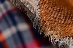 Frayed (Dreaming of the Sea) Tags: macromondays nikon nikond7200 red gold tamronsp90mmf2811macro dof depthoffield hmm cloth