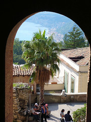 Through the keyhole. (Country Girl 76) Tags: taormina sicily italy buildings architecture naxos bay people courtyard sea trees archway