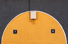 79 (HWHawerkamp) Tags: abstract numbers orange grey wall electric signs box pipe wire wires round white yellow facade cement geometric