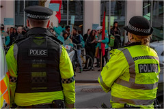 Watching (Fermat 48) Tags: demonstration demo manchester citycentre deliveroo police watching demands oxfordstreet peaceful canon eos 7dmarkii camera hivizjacket yellow high visibility