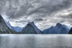 Mitre Peak (myshutterworld) Tags: newzealand south island landscape mountains peaks serene picturesque gorgeous southland milfordsound hdr spectacular beautiful mind blowing amazing middle earth heavenonearth lake fiordlandnationalpark cloudy dark blue green water nature sky grass trees rocks fiord snowcapped mitre peak lion