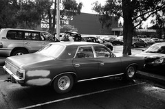 1981 Chrysler Regal, yay! (Matthew Paul Argall) Tags: kodakstar500af 35mmfilm ilforddelta100 100isofilm blackandwhite blackandwhitefilm car vehicle automobile transportation oldcar classiccar carspotting chryslerregal chryslervaliant chrysler mopar