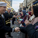 Sailors assigned to Navy Band Southeast greet spectators in the King Felix III Mardi Gras Parade.