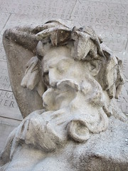 USS Maine Monument - Personification of Pacific Ocean Figure 2273 (Brechtbug) Tags: uss maine monument 1913 beaux arts commemorate controversial sinking battleship 1898 the ship has sculpted representations mythological figures victory peace courage fortitude justice central park entrance nyc 02192019 new york city arms wrapping around rock statue sculpture february 2019 columbus circle