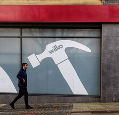 Heading for Disaster (Mr_Pudd) Tags: huddersfield panasonicgx8 advertisinghoarding advert hammer passerby wilko window paving man boy brick tiles