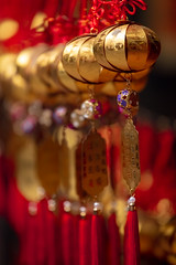 Temple Bells (josullivan.59) Tags: 2019 asia buddism china hongkong january kowloon tinhau ancient bells city closeup day decorative detail gold inside interior old orange oriental red rich temple yellow travel wallpaper 3exp texture telephoto dof light