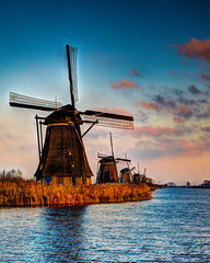 Kinderdijk Windmills (James Mc2) Tags: windmill holland rotterdamkinderdijk netherlands water grass sunset winter thatched roof clouds unesco yellow blue beautiful nature river