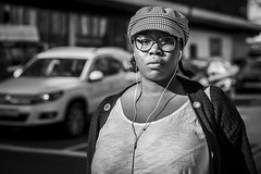 Scrutiny (Leanne Boulton) Tags: urban street candid portrait portraiture streetphotography candidstreetphotography candidportrait streetportrait eyecontact candideyecontact streetlife woman female girl face eyes expression mood emotion feeling cap hat glasses earbuds sunlight winter tone texture detail depthoffield bokeh naturallight outdoor light shade shadow city scene human life living humanity society culture lifestyle people canon canon5dmkiii 70mm ef2470mmf28liiusm black white blackwhite bw mono blackandwhite monochrome glasgow scotland uk