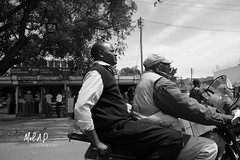 The Urban Transport Collection (JeepChic) Tags: streetphotography urbanlife city citylife africa kenya blackandwhite travel internationaltravel transport transportation motorbike men